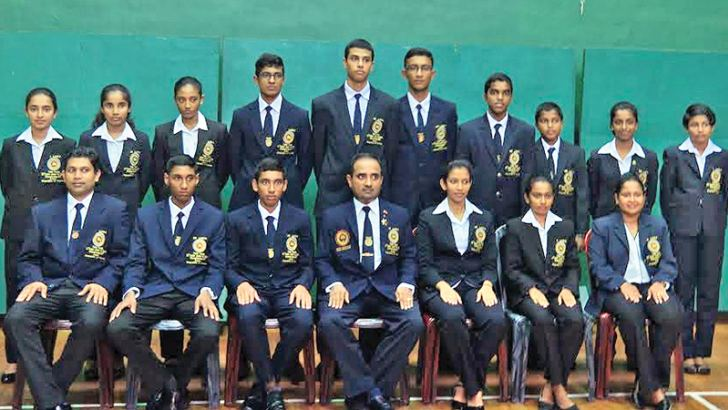 Seated from left: Wajira Wickramasinghe (Coach), Chandupa Alahakoon (Cadet Boys' Captain), Dinesh Kavishka (Junior Boys' Captain), Dr. (Eng.) Lalith Liyanage (Team Manager / VP, TTASL), Hansani Piyumila (Junior Girls' Captain), D H Kolambage (Cadet Girls' Captain), Sanduni Kavithilaka (Lady Chaperon). Standing from left: Thanushi Rodrigo, Imasha De Silva, Jithara Warnakulasuriya, Dewmith Weerasena, Virunaka Hendahewa, Dishanka Thennakoon, Nimesh Ranchagoda, Thisas Ranchagoda, Chamathsara Fernando, Sanduni P