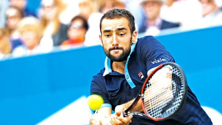 Croatia's Marin Cilic returns against Spain's Feliciano Lopez during the men's singles final tennis match at the ATP Aegon Championships tennis tournament at Queen's Club in west London on June 25. AFP