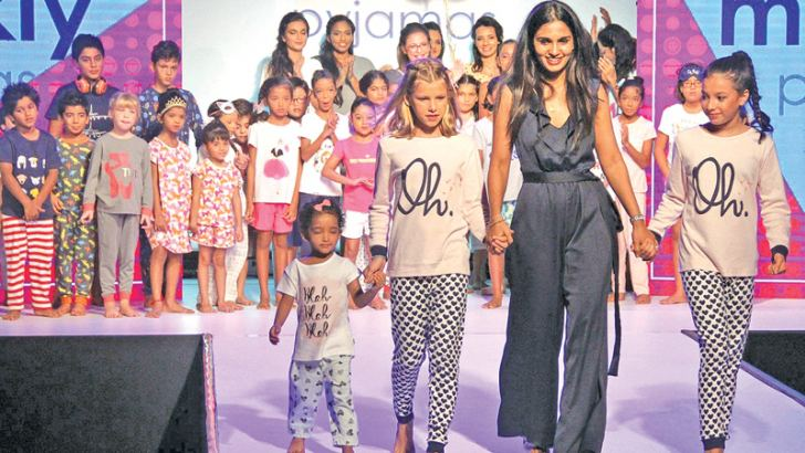 Sharmila  Srikumar with the models