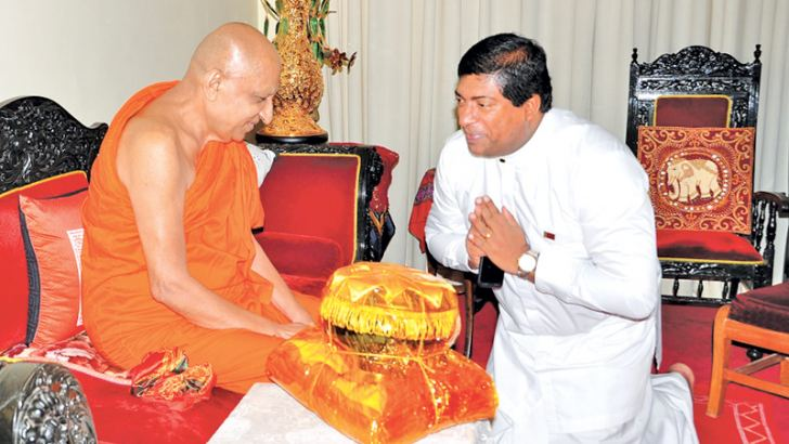 Minister Ravi Karunanayake calls on the Malwatte Prelate at his aramaya in Kandy and received blessings. Picture by Gamini Ranasinghe