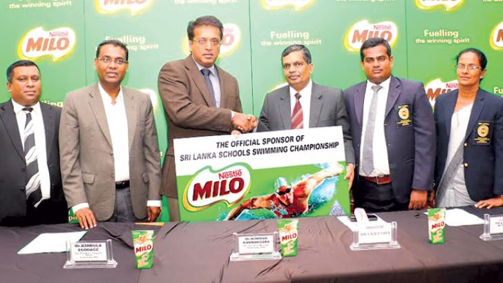 Nestle Lanka Vice President Norman Kannangara handing over the sponsorship cheque to the SLSASA president Y. A. N. D. Yapa. Others in the picture: Nestle Lanka Senior Manager Sajeewa Wickramasinghe (left extreme), Nestle Lanka VP, Bandula Egodage (2nd from left), SLSASA secretary Krishan Duminda (2nd from right), SLSASA treasurer T. D. Perera.