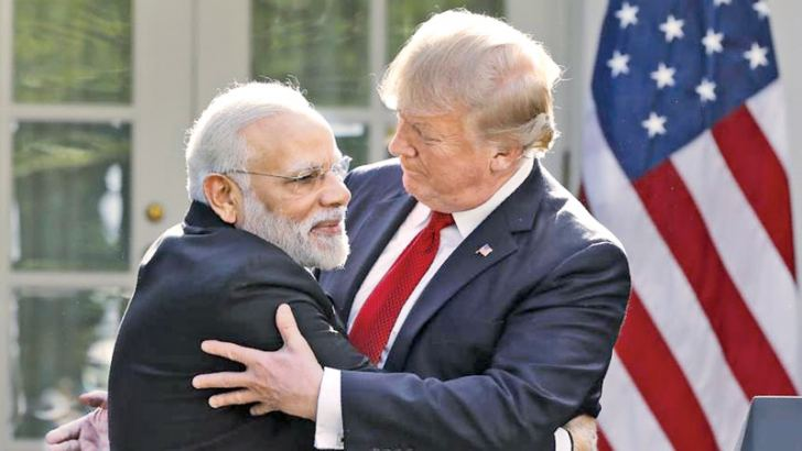 Indian Prime Minister Narendra Modi hugs U.S. President Donald Trump as they give joint statements in the Rose Garden of the White House in Washington on Monday. - AFP