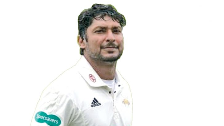 Kumar Sangakkara celebrates becoming the first batsman to reach 1000 runs in the current English season.
