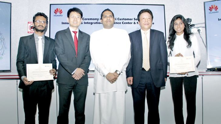Two students from Moratuwa and Kelaniya Universities who attended the Huawei training programme in China recently with Minister Harin Fernando and Yang Zuoyuan from the Chinese Embassy in Sri Lanka. Picture by Saliya Rupasinghe