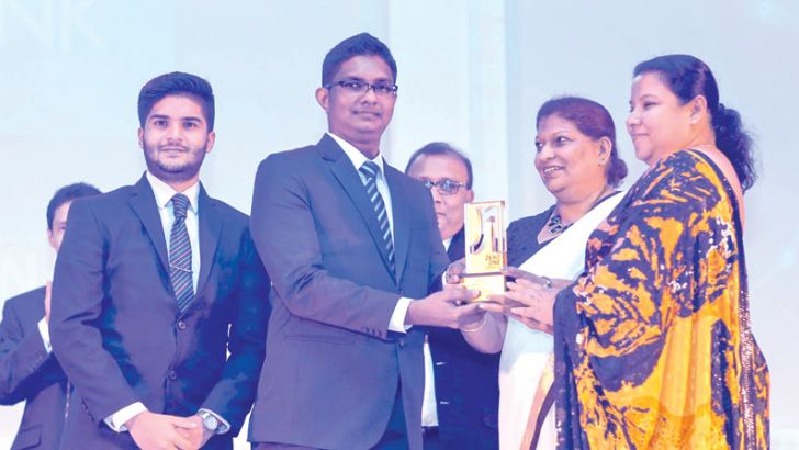 Representatives of Commercial Bank receiving the SLT Zero One Award for 'Best Website or Microsite  Finance Sector.