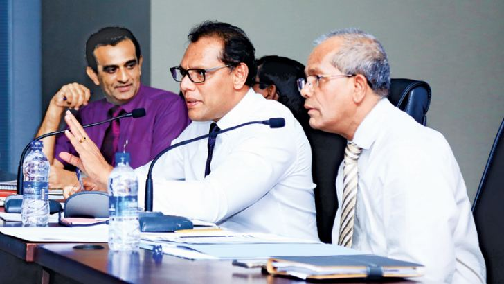 Sports Minister Dayasiri Jayasekera addressing presidents and secretaries of sports bodies regarding the selection of competitors for the Commonwealth Games. Secretary of the National Olympic Committee Maxwell de Silva and Deputy Director of Sports I P Wijeratne are also in the picture.