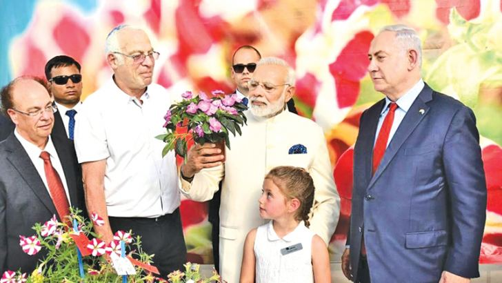 Prime Minister, Narendra Modi with his Israeli counterpart Benjamin Netanyahu,visiting the Danziger Flower Farm- a leading facility for R&D in plant varieties, in Tel Aviv, Israel on Tuesday. - AFP