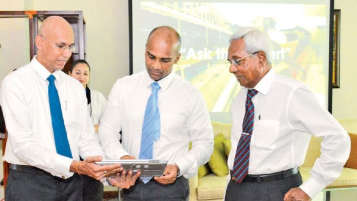 """Nishan Weerasooriya, Deputy Chairman unveiling FINCO Engineering's new website, equipped with a technical hub  """"Ask the Expert"""" looked on by Rohan Delgoda, Managing Director and Ranjan Dissabandara, Chief Operating Officer. Picture by Sarath Peiris"""
