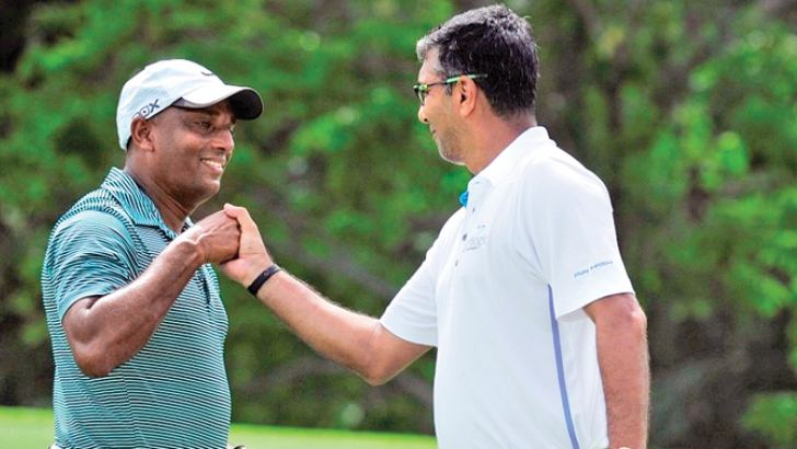 Dr. Janaka Gallangoda (left) and Dihan D. Dedigama of Softlogic Holdings sharing a moment during the 106th Shakspeare Shield golf tournament at RCGC.