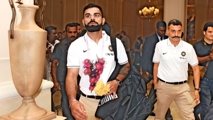 Indian cricket team captain Virat Kohli (L) arrives with teammates at a hotel in Colombo on July 19. AFP