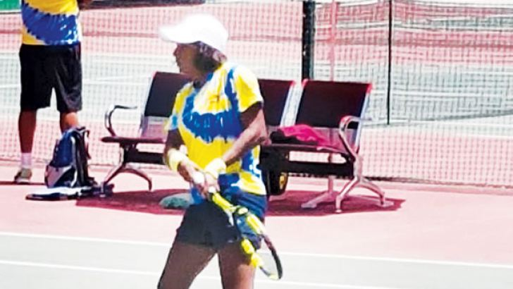 Medhira Samarasinghe in action during the singles match against Aigerim Akzhol Kyzy of Kyrgyzstan