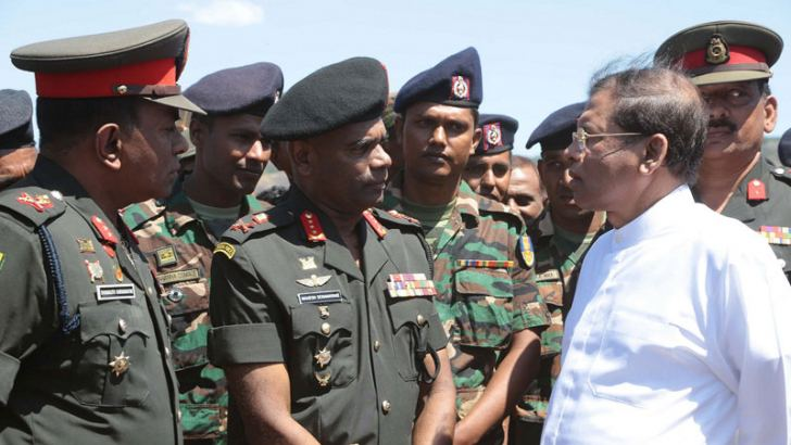 President Maithripala Sirisena with Army Commander Lt. Gen.Mahesh Senanayake, Army Chief Field Engineer Major General Dananjith Karunaratne and officers at the handing over in Kantale yesterday.