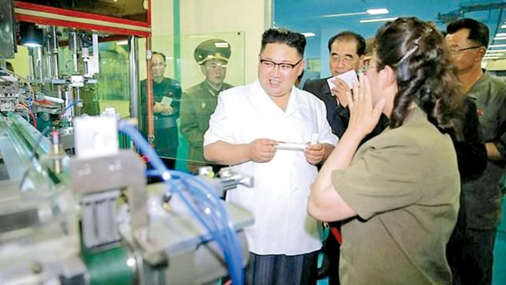 North Korean leader Kim Jong-Un (C) visiting a newly-built dental sanitary goods factory at an undisclosed location in North Korea.- AFP