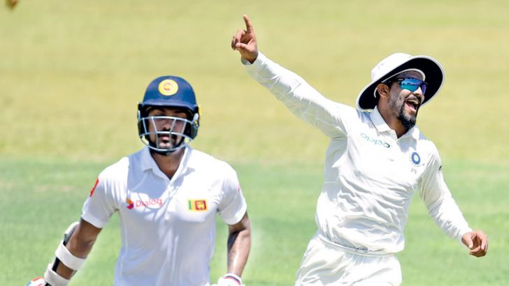 India's Ravinda Jadeja celebrates running out of SLC President's XI opener Danushka Gunathilaka for 74 on the opening day of the two-day warm-up match played at the CCC grounds yesterday.  AFP