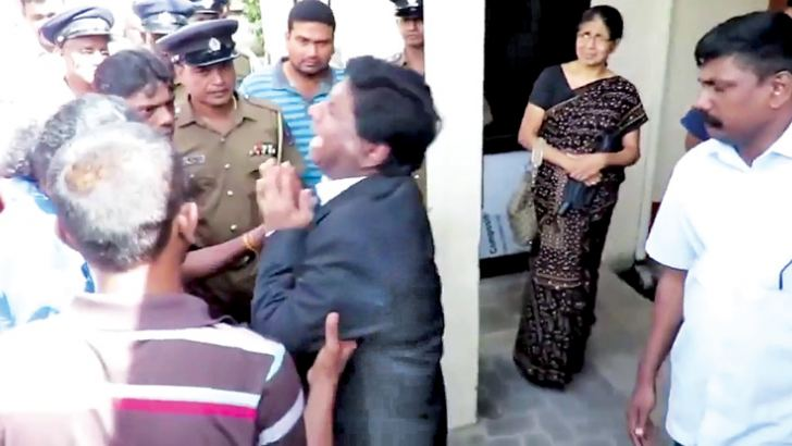 Jaffna High Court Judge M. Ilancheliyan broke down when he met the wife and relatives of  Police Sergeant Sarath Premachandra (51) who died during the shooting at Nallur on Saturday. The Policeman had been escorting the Jaffna High Court Judge, currently presiding over the Sivaloganathan Vidya case. Picture by Bandula Seneviratne Vavuniya North Group Corr.