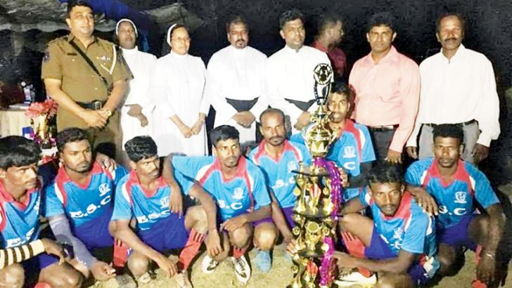 The champion Sori Kalmunai Elmo SC Football team is seen here with the trophy