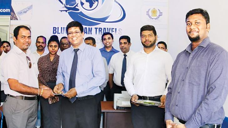 Blue Ocean Group Chairman S. Thumilan handing over a ticket to a customer