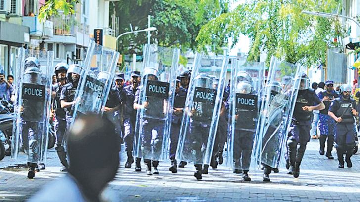 Police block the road leading to the Parliament building in Male, Maldives on Monday.