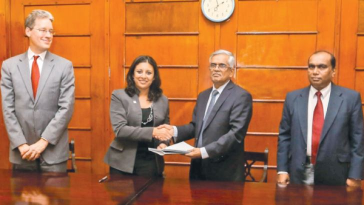 MCC's Fatema Z. Sumar exchanges the agreement with Treasury Secretary Dr R.H.S. Samaratunga