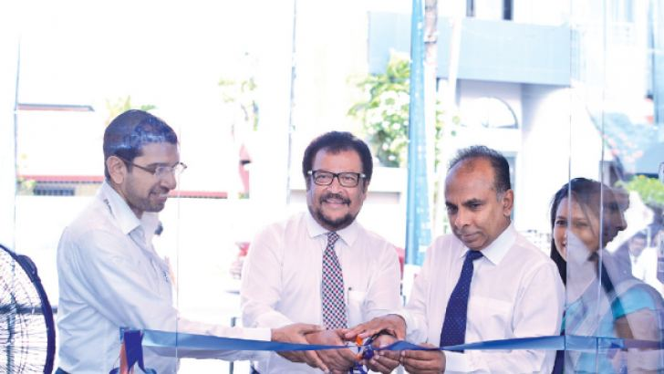 Thilak De Silva, Group Managing Director of LAUGFS Holdings Limited  together with the LAUGFS Senior Management team at the opening ceremony of the new ClickNshopCentre.