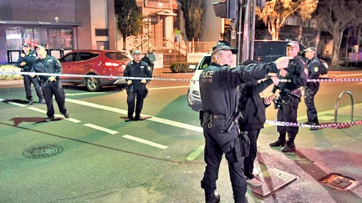Police man a check point in the Sydney inner suburb of Surry Hills on Saturday.- AFP