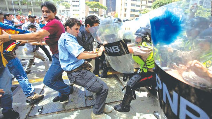 Protestors clashing with Police in Caracas.
