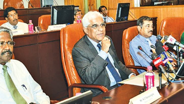 Central Bank Governor Dr. Indrajit Coomaraswamy and Deputy Governor Nandalal Weerasinghe. Picture by Wimal Karunatillike