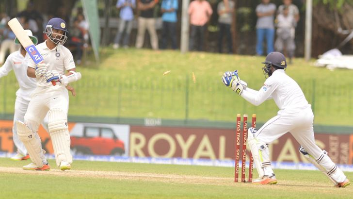 Sri Lanka wicket-keeper Niroshan Dickwella stumps India's Ajinkya Rahane for 132 on the second day of the second cricket Test played at the SSC grounds yesterday. (Pic by Saman Mendis)