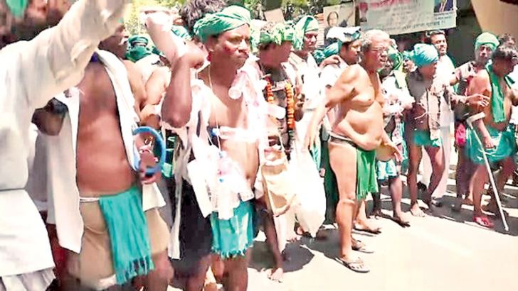 Farmers protesting,  demanding waivers  of their loans.