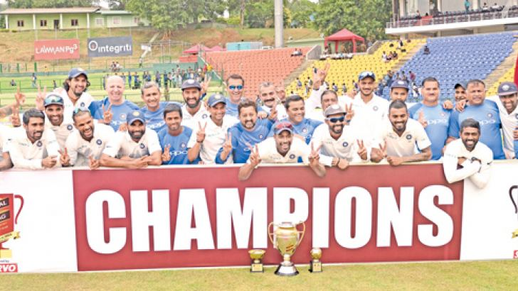 The winning Indian team celebrate their 3-0 series whitewash of Sri Lanka in the Test series that ended at the Pallekele International Stadium yesterday. Picture by Rukmal Gamage