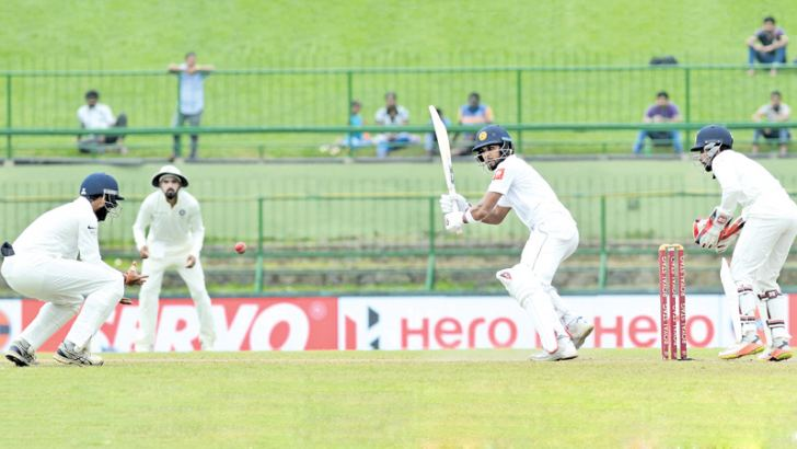 Sri Lanka captain Dinesh Chandimal about to be caught at leg gully by India's Cheteswar Pujara for 36 in the second innings of the third and final cricket Test at the Pallekele International Stadium yesterday. (Pictures by Rukmal Gamage)