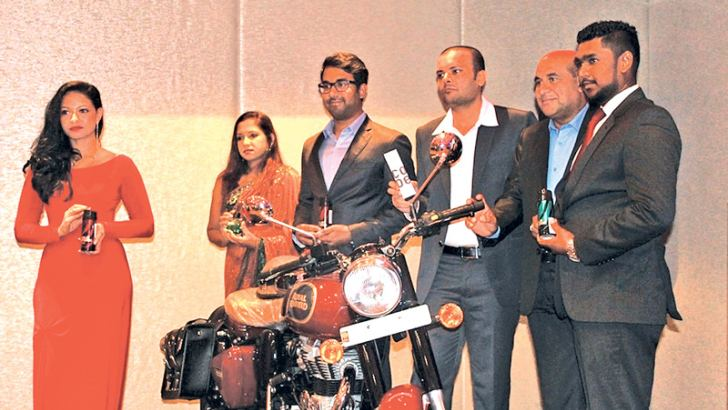 Nirangi Subashini, Senior Brand Manager  American Remedies, Rishard Rheyas, Director American Remedies; Nikunj Mehetha, Export Manager American Remedies; Ahammed Rheyas, Chairman  American Remedies and Mohamed Rushdi, Key Accounts Manager American Remedies, with the brand new Royal Enfield Classic 350 motorbike