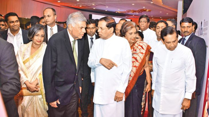 President Maithripala Sirisena who was the Chief Guest at the Heta Dakina Ranil special photo exhibition at the BMICH is seen in conversation with Prime Minister Ranil Wickremesinghe. Former President Chandrika Bandaranaike Kumaratunga, Minister Rajitha Senaratne, Prof. Maithree Wickramasinghe were among those who participated in the event. Picture by Sudath Malaweera