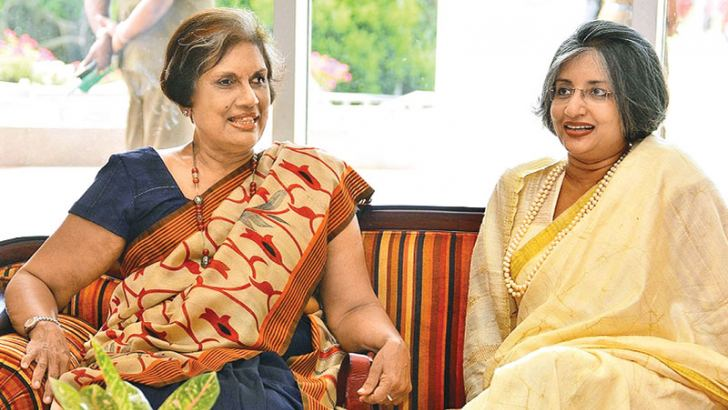 Former President Chandrika Bandaranaike Kumaratunga with Prof. Maithree Wickramasinghe at the 'Encounter Ranil' exhibition opening yesterday. Picture by Sudath Malaweera.