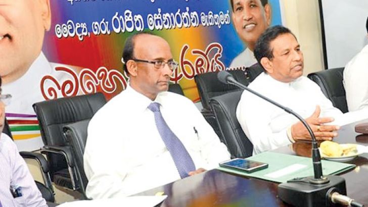Health Minister Dr. Rajitha Senaratne and officials at the discussion.