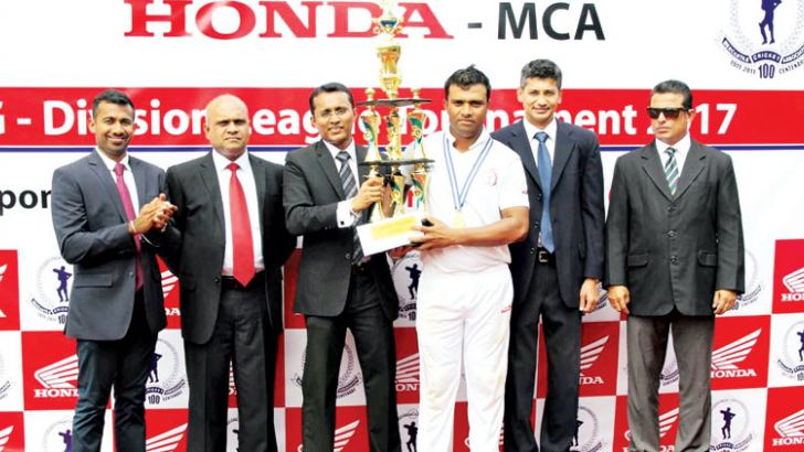 Maliban Biscuits captain Tharindu Siriwardena (3rd from right) receiving the 'Honda' Trophy from the chief guest, Director/Chief Operating Officer, Stafford Motor Co. (Pvt) Ltd., Charaka Perera (3rd from left). Others in the picture from left: Tarindra Kaluperuma (Secretary, Tournament Committee/MCA), Damitha Jayasundera (Deputy General Manager - Stafford Motor Co. (Pvt) Ltd.), Niran Mahawatte (President/MCA) and Roshan Iddamalgoda (Snr. Vice President /MCA)