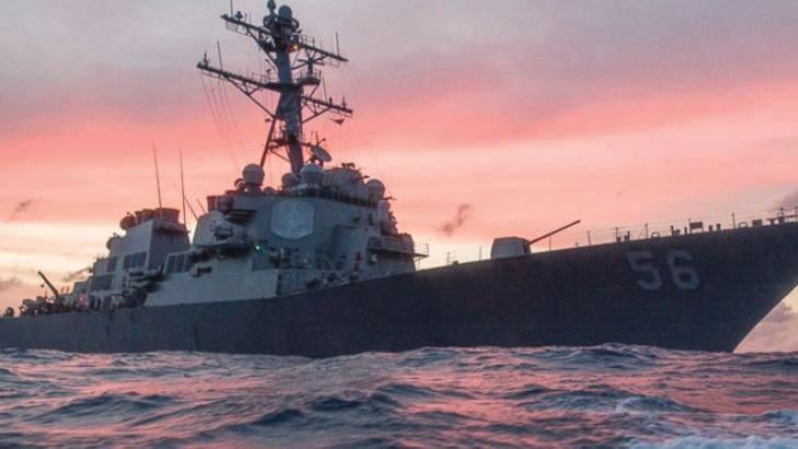 The Japan-based Seventh Fleet said the USS McCain was heading to Singapore for a routine port visit.