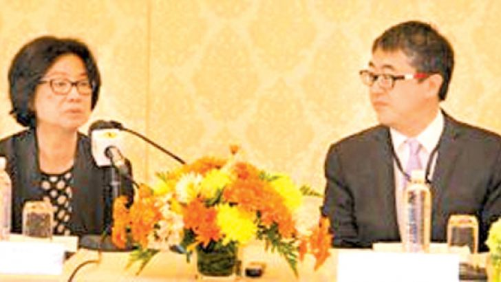 Sri Widowati,ADB Country Director addressing the press conference looked on by Tadateru Hayashi, Senior Country Economist. Picture by Mahinda Vithanachchi