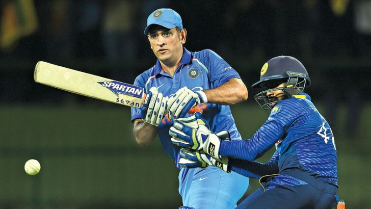 MS Dhoni playing a familiar innings to guide India to victory. - AFP