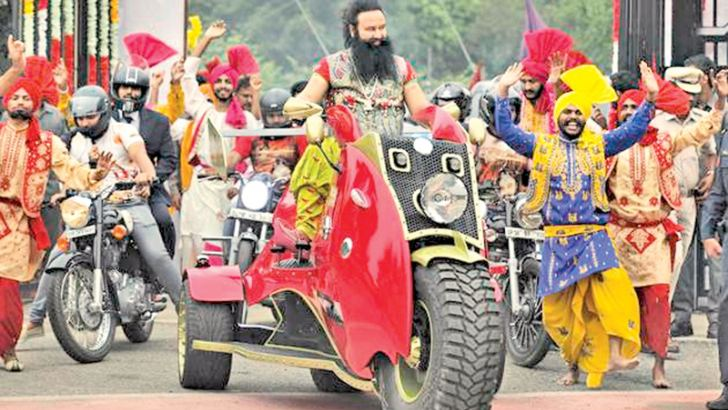 Gurmeet Ram Rahim Singh arrives for a press conference with his followers.