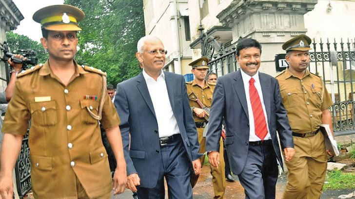 Former President's Secretary Lalith Weeratunge and former Telecommunications Regulatory Commission (TRC) Director General Anusha Palpita being escorted from Court after being sentenced. Picture by Thushara  Fernando.