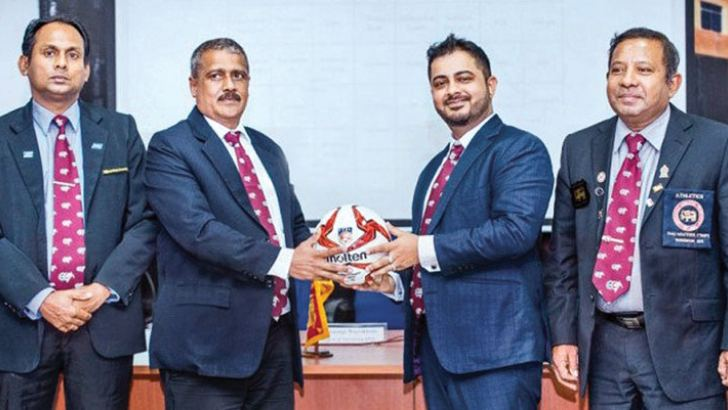 Mercantile Services Football Association president Saif Usoof (2nd from right) handing over the official ball to the Tournament Committee president George Weerakkody. Mercantile Services Football Association Senior Vice-Presidents Sydney Ratnayake (right extreme) and Piyal Perera are also present.