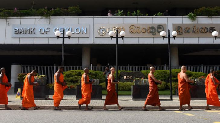 Monks on foot collecting money to pay the fine imposed on two ex-State officials. Picture by Ishara Kodikara