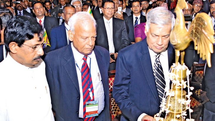 Prime Minister Ranil Wickremesinghe lighting the tradional oil lamp to inaugurate the Asian Credit Union Forum 2017 hosted by The SANASA Federation of Sri Lanka at the Galadari Hotel,Colombo yesterday. Picture by Saman Mendis