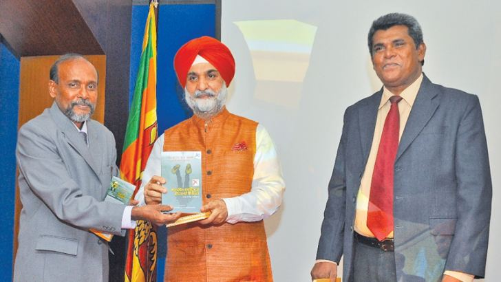 (Left to right )  Kelaniya University, HOD, Hindi Studies, Prof. Upul Ranjith Hewawitanagamage,   Indian High Commissioner, Taranjit Singh Sandhu and  University of Kelaniya, VC, Prof. D.M.Semasinghe
