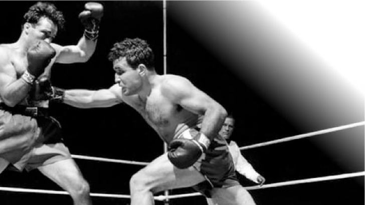 Jake 'Raging Bull' LaMotta in the 13th round of his final fight with Sugar Ray Robinson in 1951.