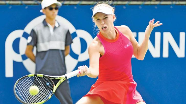 Caroline Wozniacki of Denmark hits a return against Anastasia Pavlyuchenkova of Russia on September 24, - AFP