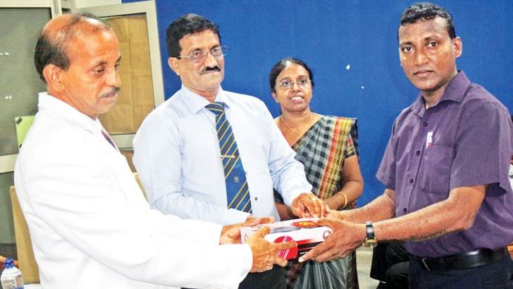 K.G.Wimalasena,Principal of Lumbini Vidyalaya,Colombo and Vice President of the Sri lanka Schools Cricket Association presenting cricket balls to the Cricket Coach of Anula Vidyalaya