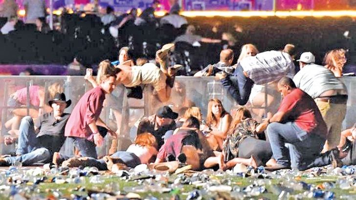 Hundreds of concert-goers fled the scene or ducked for cover amid heavy gunfire.
