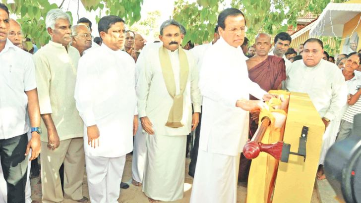 President Maithripala Sirisena unveiling the plaque to mark the opening of the golden fence around the Bo-tree abode of Danagedara Jayawardana ancient temple. Southern Province Governor Dr. Hema Kumara Nanayakkara and Southern Province Chief Minister Shan Wijayalal de Silva, and Minister Wajira Abeywardena are also present. Picture by Mahinda P. Liyanage, Galle Central Special Correspondent